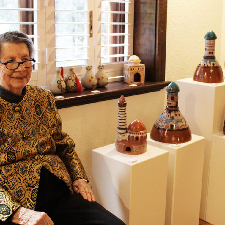 Judy Lorraine with come of her ceramics work at the opening of her exhibition at WAS Gallery